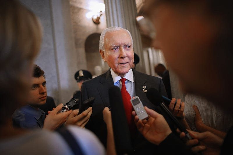 Sen. Orrin Hatch talks with reporters after leaving the Senate floor at the U.S. Capitol on May 18, 2015, in Washington, D.C.  (Chip Somodevilla/Getty Images)
