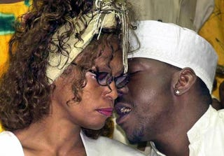 Whitney Houston and then-husband, Bobby Brown, attend a welcoming ceremony hosted by the polygamous Black Hebrew sect on May 30, 2003, in the southern Israeli town of Dimona. Houston was in Israel for a week to make a recording with the sect.MEIR AZULAI/AFP/Getty Images