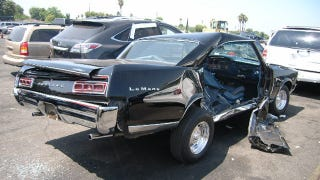 Illustration for article titled 1967 Pontiac LeMans that was victim of brutal Lexus attack turns up at auction