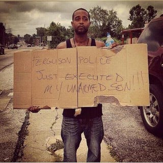 All eyes on Ferguson, Mo.: Louis Head, Michael Brown Jr.'s stepfather, sending out the SOS Aug. 9, 2014Twitter
