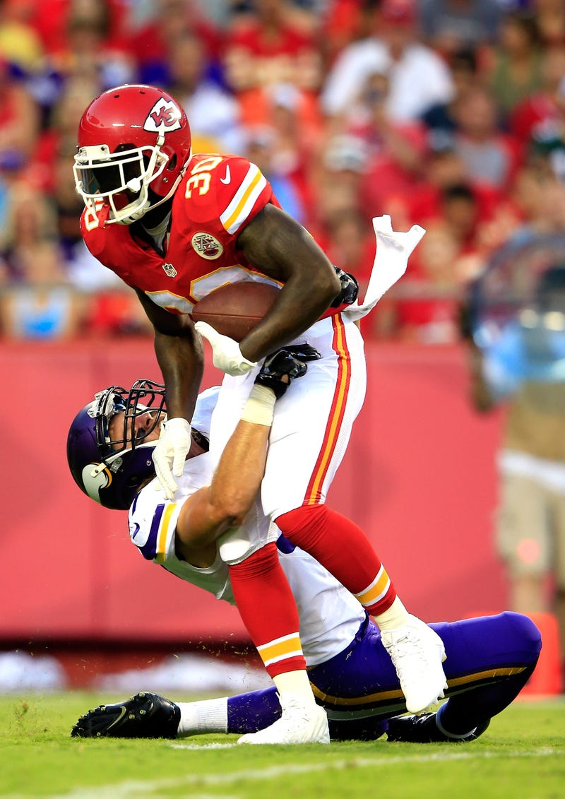 Joe McKnight, No. 30, of the Kansas City Chiefs is tackled by Audie Cole, No. 57, of the Minnesota Vikings  at Arrowhead Stadium in Kansas City, Mo., on Aug. 23, 2014.(Jamie Squire/Getty Images)