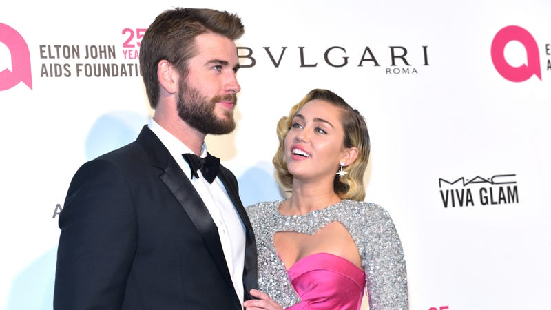 Illustration for article titled Miley Cyrus and Liam Hemsworth May or May Not Be Married, but They Definitely Had Cake