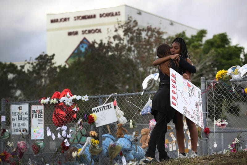 Tyra Heman (right), a senior at Marjory Stoneman Douglas High School, is hugged on Feb. 19, 2018, by Rachael Buto in front of the school, where 17 people were killed on Feb. 14, 2018, in Parkland, Fla.
