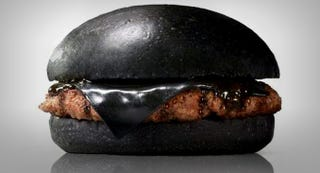 Illustration for article titled Burger King's all-black burger looks absolutely disgusting in real life