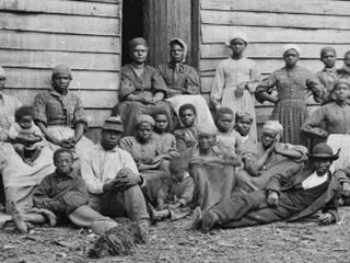A group of escaped slaves gather outside a cabin in 1861. (MPI/Getty Images)