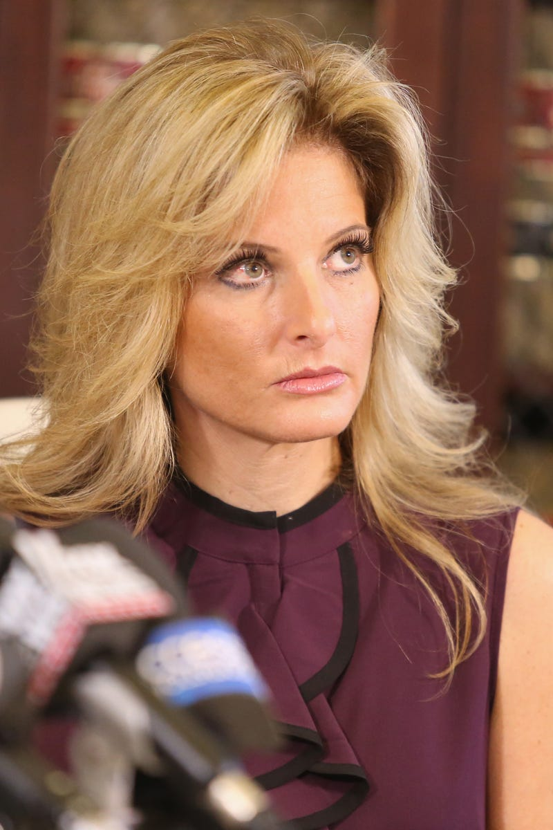 Summer Zervos, a former candidate on The Apprentice, season five, who is accusing Donald Trump of inappropriate sexual conduct, speaks to the press with her attorney Gloria Allred on Oct. 14, 2016, in Los Angeles.Frederick M. Brown/Getty Images