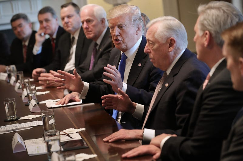 President Donald Trump (center) presides over a meeting about immigration with Republican and Democrat members of Congress at the White House on Jan. 9, 2018. (Chip Somodevilla/Getty Images)