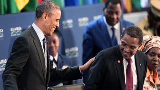 """President Barack Obama talks with Tanzanian President Jakaya Mrisho Kikwete as they arrive at """"Session 3: Governing the Next Generation"""" at the U.S.-Africa Leaders Summit in Washington, D.C., Aug 6, 2014.JIM WATSON/AFP/Getty Images"""