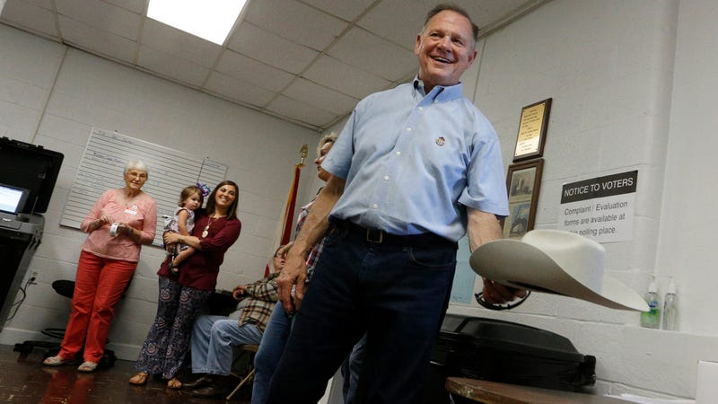 Alabama Republican U.S. Senate candidate Roy Moore places his hat on a table as he enters the Gallant Fire Hall to vote in the GOP runoff election Sept. 26, 2017, in Gallant, Ala. Moore is running against Sen. Luther Strange (R-Ala.) to fill Jeff Sessions' seat. (Hal Yeager/Getty Images)