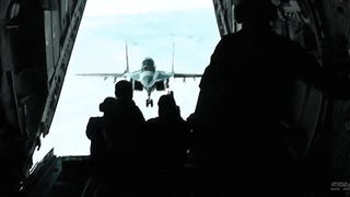 Video: MiG-29 flies impossibly close to an airplane's open rear door