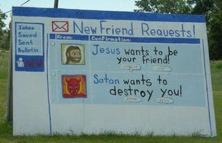 Illustration for article titled Satan and Jesus Fighting for Your Facebook Soul