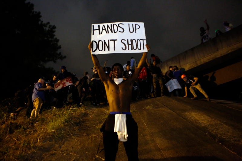 Activists attempt to make their way onto Interstate 277 to block traffic as they march in the streets Sept. 22, 2016, in Charlotte, N.C., to protest the death of Keith Lamont Scott.Brian Blanco/Getty Images