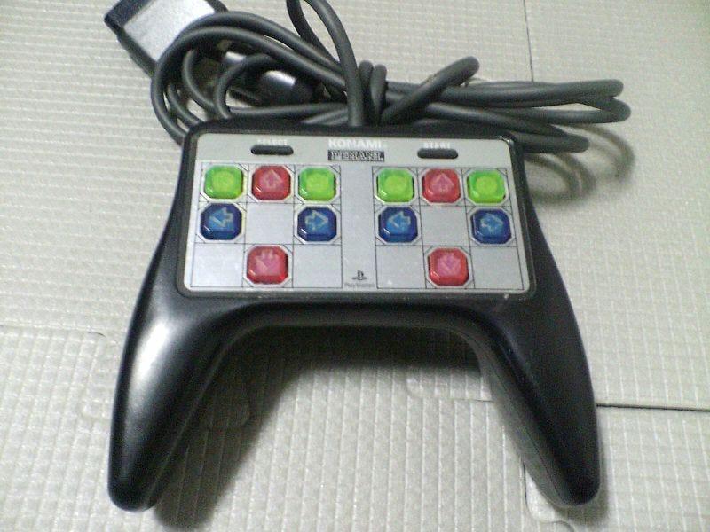 Illustration for article titled Konami Made A Handlheld Dance Dance Revolution Controller