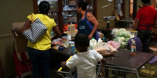 Families stock up on goods at a New York City food pantry. (Spencer Platt/Getty Images)