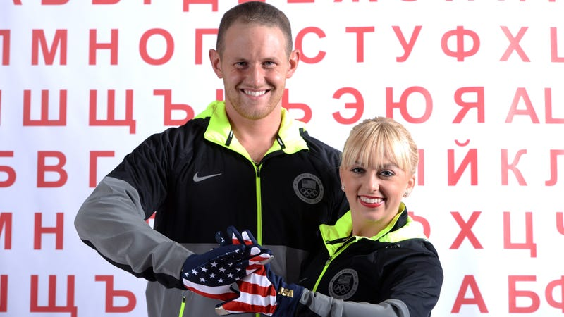 John Coughlin (left) and Caydee Denney (right) pose during the USOC Media Summit for the Sochi 2014 Winter Olympics.