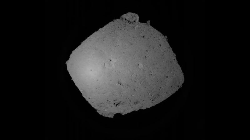 A view of the Ryugu asteroid during the September 12 rehearsal. This image was taken when Hayabusa2 was at a distance of 2,080 feet (635 meters). Amazingly, you can actually see the shadow of Hayabusa2—it's that tiny dark spot in the bright region at center left (the brightness is caused by the Sun's reflection).