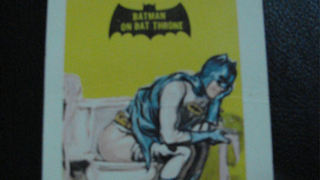 Illustration for article titled A Trading Card Of Batman Pooping Is On Ebay For Thousands Of Dollars