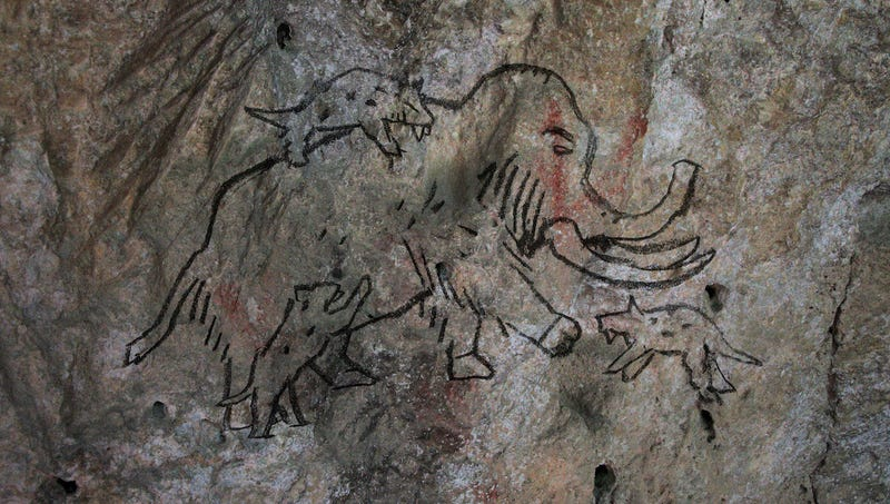 Illustration for article titled Unearthed Cave Painting Of Wooly Mammoth, Saber-Tooth Tiger Reveals Humans Have Debated What Things Would Win In A Fight Since 30,000 B.C.