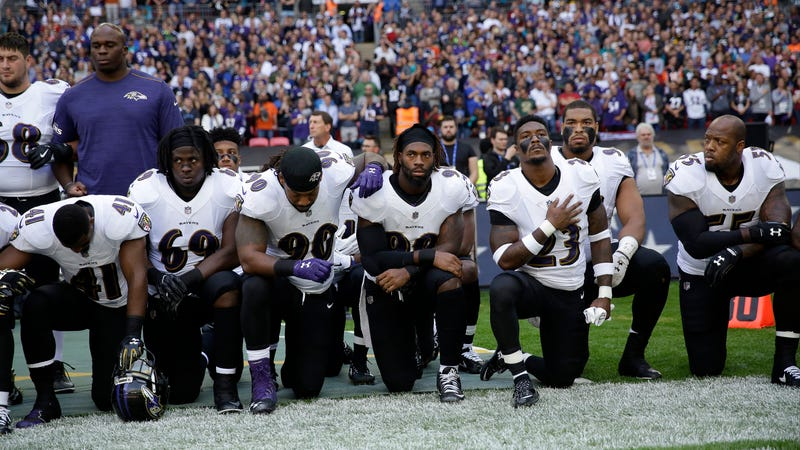 Baltimore Ravens taking a knee this morning in game against the Jacksonville Jaguars in London. Image via the AP.