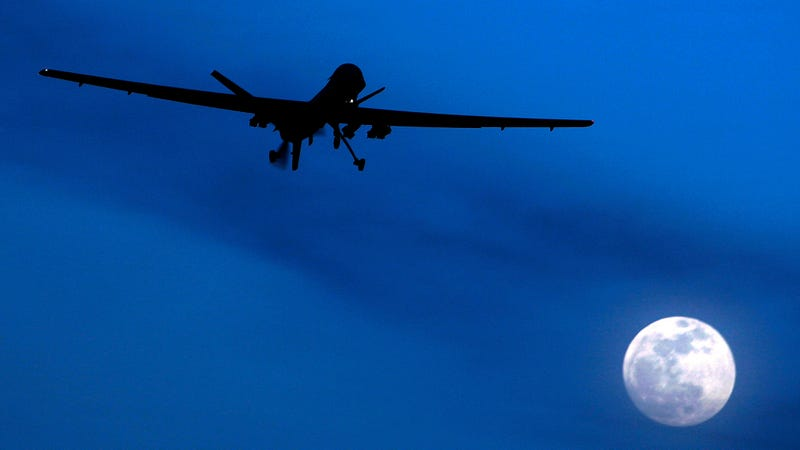 An unmanned U.S. Predator drone flies over Kandahar Air Field, southern Afghanistan, on a moon-lit night.