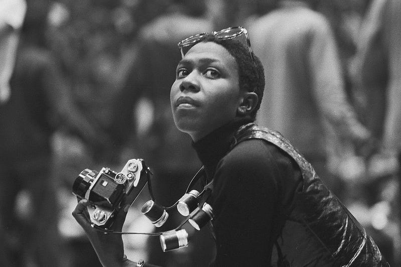 Political and social activist and Black Panther member Afeni Shakur looks up while photographing the scene during a rally in support of the Panther 21 in New York City on April 4, 1970.David Fenton/Getty Images