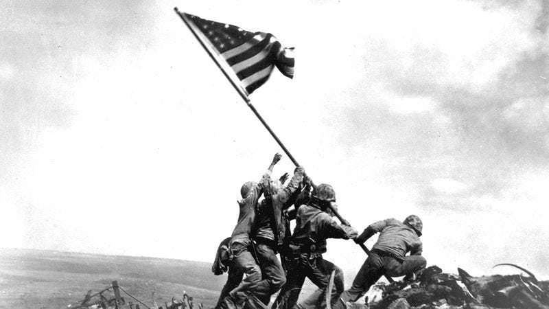 Soldiers raising the American flag.