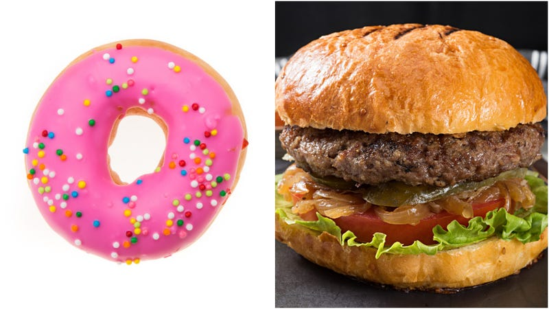 Illustration for article titled Today in giant food: Would you rather eat a 5-meat burger or a 4-handed doughnut?