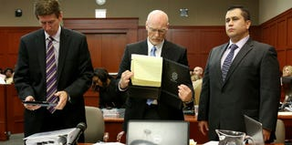 Defense attorneys Mark O'Mara (left) and Don West with George Zimmerman at the July 3 proceedings (pool/Getty Images)