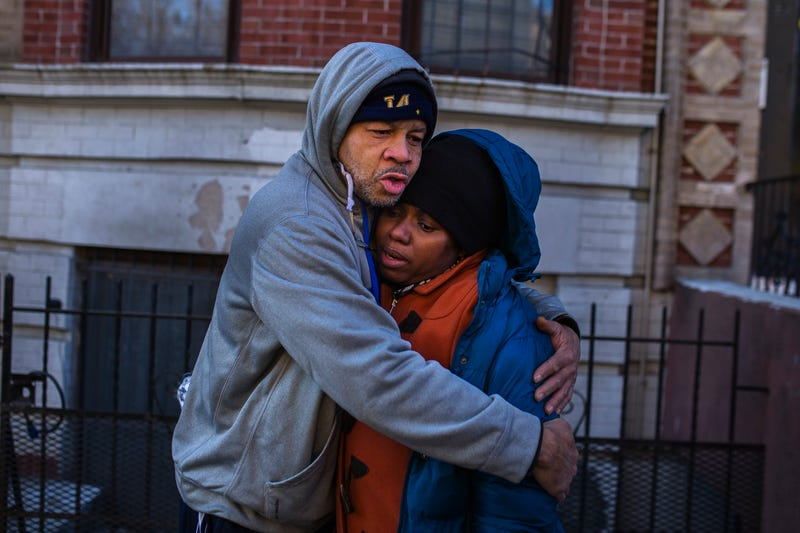 Emelia Ascheampong (right), a resident of the building where more than 10 people died in a fire Thursday, is embraced by a friend Dec. 29, 2017, in the Bronx borough of New York City. (Andres Kudacki/AP Images)
