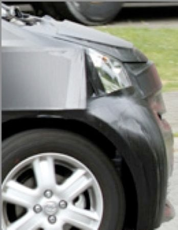Illustration for article titled Toyota iQ Spotted, Gary Sinise Hiding In Back Seat?