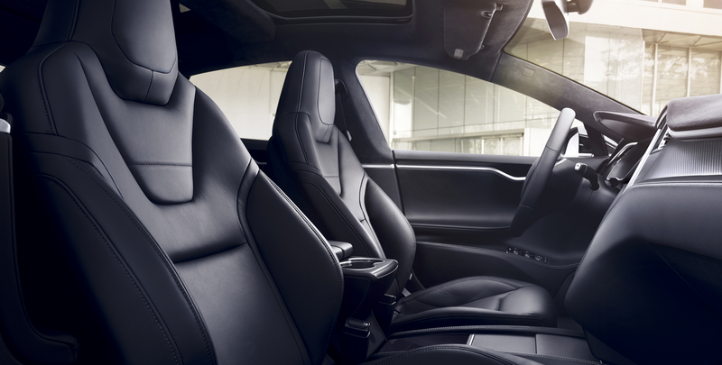 The Tesla Model S uses black seat belt buttons on U.S. spec models. Photo: Tesla