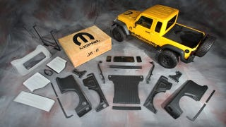 Illustration for article titled Jeep Wrangler pickup kit revives American manliness for just $5,499