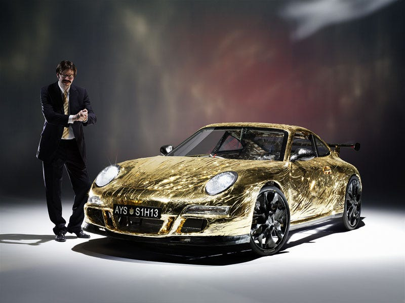 Illustration for article titled Artist Builds Aluminum Foil Porsche, Takes It On Track