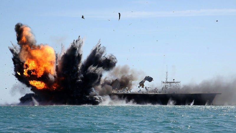 Illustration for article titled Iran Blows Up Gigantic U.S. Carrier Mock-Up During Naval Exercise