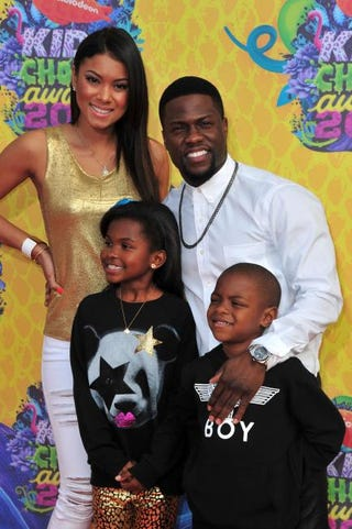 Kevin Hart, with girlfriend Eniko Parrish and children, attends Nickelodeon's 27th Annual Kids' Choice Awards at the USC Galen Center March 29, 2014, in Los Angeles.Frazer Harrison/Getty Images