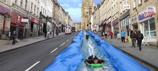 Illustration for article titled Would You Go For A Ride On This Massive Slip 'n Slide On A City Street?