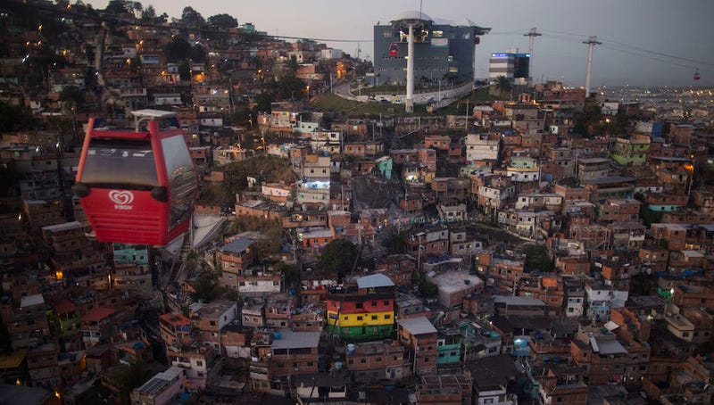 The new cable car system travels over the Complexo do Alemão favela in Rio. AP Photo/Leo Correa