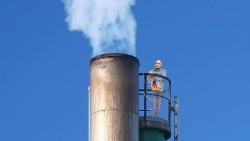 EPA head Scott Pruitt chained to a smokestack.