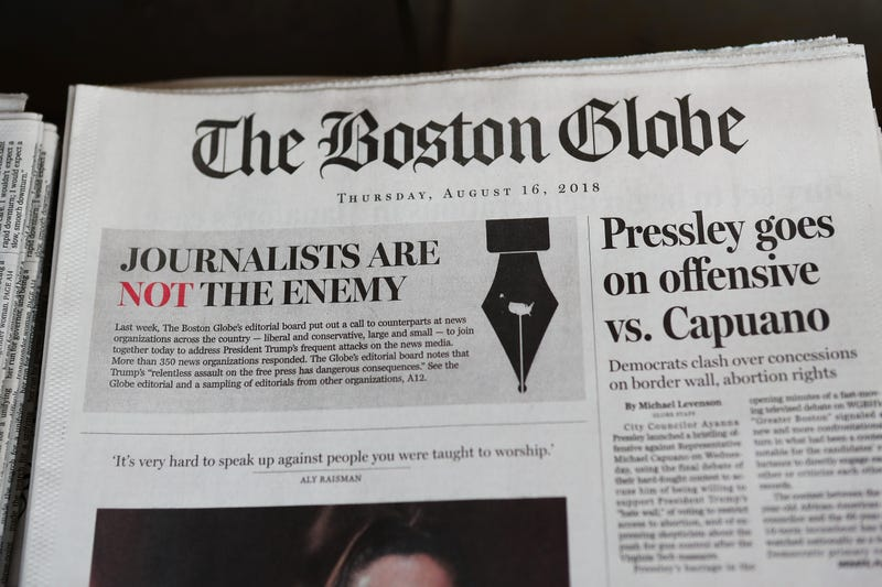 """The front page of the Aug. 16, 2018, edition of the Boston Globe reads """"Journalists are Not the Enemy"""" as part of an effort by newspapers to jointly decry Donald Trump's description of the media as the """"enemy of the people."""" Now, in what's being seen as a similar anti-press move, GOP lawmakers in Georgia are looking to put mandates on the press."""