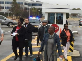 Kim King (second from right), who had worked at Renosol Seating in Selma, Ala., for nearly 10 years, is turned away by security at Hyundai's corporate offices in Montgomery, Ala. Hyundai is the exclusive customer of Renosol Seating in Selma. SELMA WORKERS ORGANIZING COMMITTEE