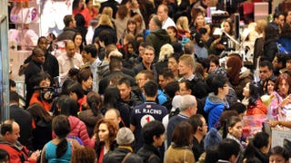 People crowd the first floor of Macy's on Nov. 23, 2012, in New York City at the start of Black Friday.STAN HONDA/AFP/Getty Images