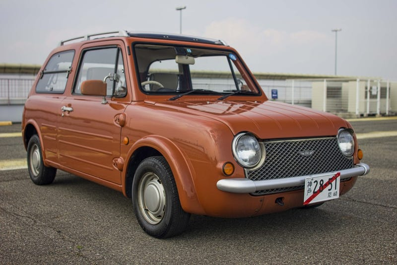 Illustration for article titled And now... Orange Nissan Pao with a sun roof!!