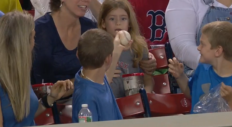 Illustration for article titled Young Red Sox Fan Hands Foul Ball To Girl Behind Him, Is The Realest