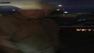 Screenshot from cellphone footage showing an unidentified man threatening churchgoers through a window of a church in Richmond, Va., June 18, 2015YouTube screenshot
