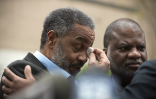 Anthony Ray Hinton wipes away tears as he stands outside the Jefferson County Jail in Alabama April 3, 2015, after serving 30 years on death row. NBC News screenshot