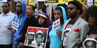 Demonstrators stand for justice for Trayvon Martin. (David McNew/Getty Images)