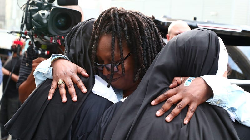 Actress Whoopi Goldberg hugs Sister Act fans during a Sister Act screening on August 3, 2017 in New York City.