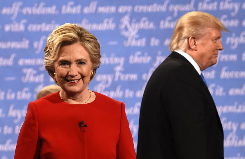 Democratic presidential nominee Hillary Clinton and Republican presidential nominee Donald Trump leave the stage after the first presidential debate at Hofstra University in Hempstead, N.Y., on Sept. 26, 2016.TIMOTHY A. CLARY/AFP/Getty Images