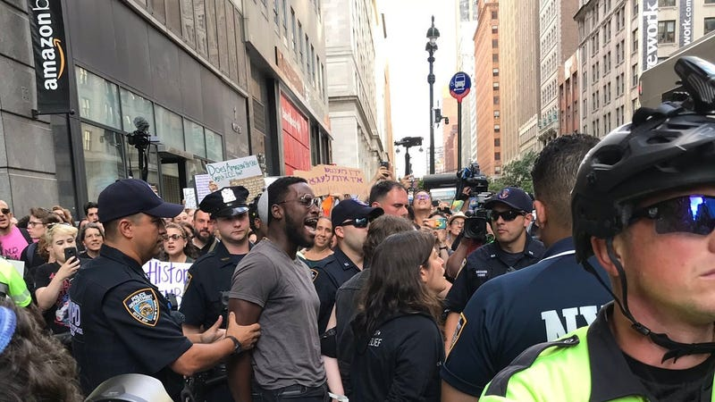 A photo released by Jews for Racial & Economic Justice of organizer Yehudah Webster being taken into custody at a protest against Amazon in Manhattan on Aug. 11, 2019.