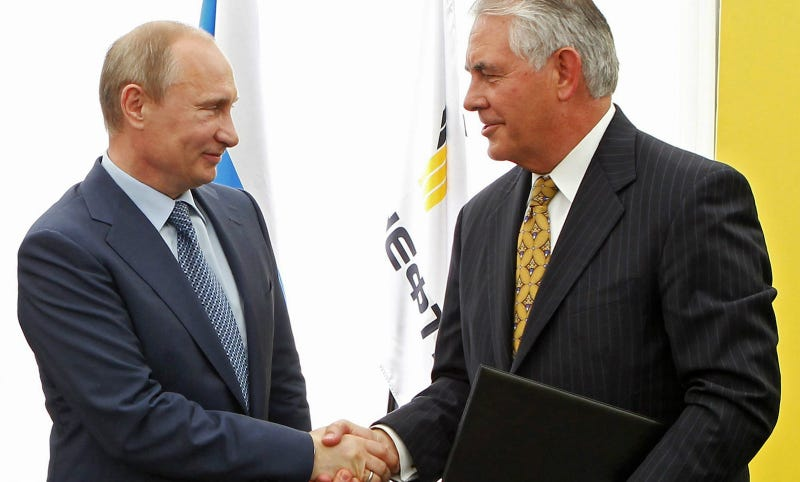 Putin and Tillerson shake hands at a signing ceremony of an agreement between state-controlled Russian oil company Rosneft and Exxon Mobil corporation at the Black Sea port of Tuapse, southern Russia, Friday, June 15, 2012. Photo via AP